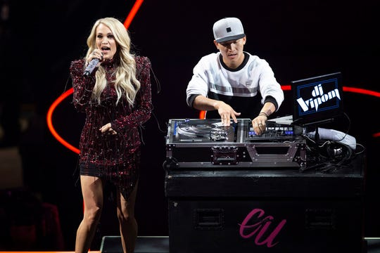 Carrie Underwood performs with DJ Vinom at Fiserv Forum in Milwaukee.