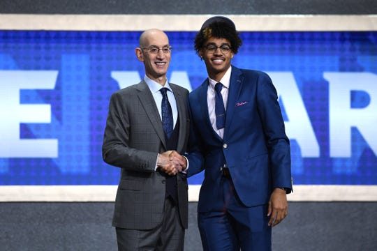 Milwaukee native Jordan Poole poses with NBA Commissioner Adam Silver after being drafted by the Golden State Warriors in the first round.