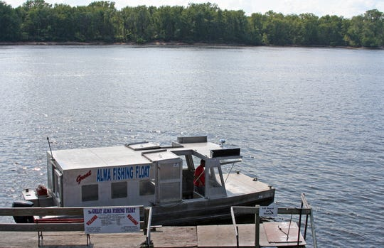 A shuttle boat waits to take visitors to the Great Alma Fishing Float.