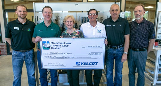 Several tournament sponsors of the Mountain Home Charity Golf Classic recently presented a check in the amount of $25,500 to ASUMH Chancellor Dr. Robin Myers, Ed.D. and Nathan Lueck, ASUMH Tech Center Director. Pictured are: (from left)Lueck;Mark Hopper, Hopper Environmental Services; Barbie Graham, Kent Chevrolet Cadillac; Dr. Myers; Matt Martin, Central Heating & Cooling; and Mike Vawter, Mountain Valley Water.The funds were raised during the annual charity golf tournament held at Big Creek Golf and Country Club on June 8-9, and will assist with equipment funding and program needs for the Technical Center.