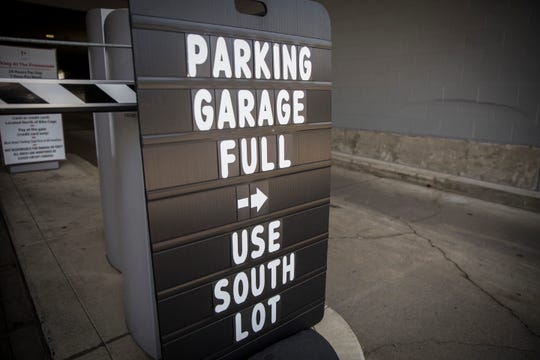 The Martin Street entrance of the Village Promenade garage shows a parking lot full sign in front of it even though the garage remains fairly empty. According to officials the garage has been fully leased by both the apartments and commercial businesses.
