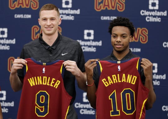 Cleveland Cavaliers' Dylan Windler, left, and Darius Garland hold up jerseys during a news-conference, Friday, June 21, 2019, in Independence, Ohio.