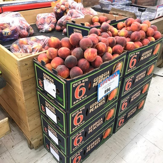 Pearson Farm peaches moving quickly in the Murphy's Cee Bee store in Charlotte, Tenn. in Dickson County.