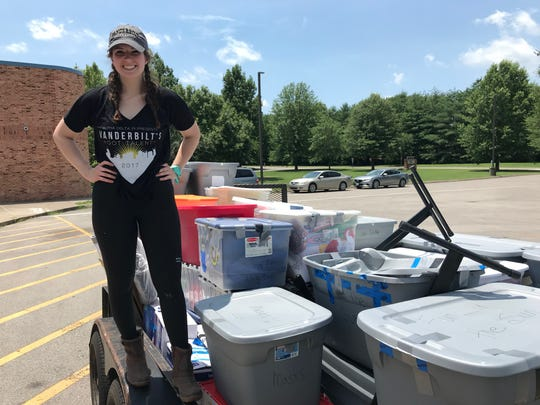 Lane Chesler, an intern at Tractor Supply Co., stands by the trailer that she helped to pack at Poplar Grove School on June 21, 2019.