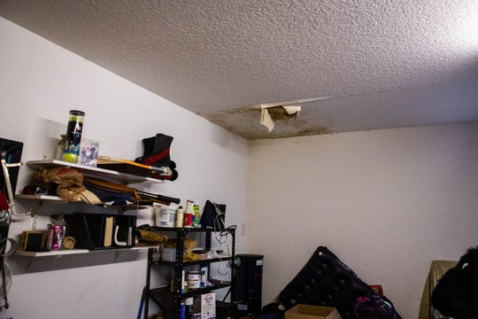 Water damage in the bathroom of Marc Schnee's garage in Naples on Friday, June 21, 2019. Schnee, as well as other customers of Campbell Roofing, have accused Joshua Campbell of taking their deposits and not completing their roofs.