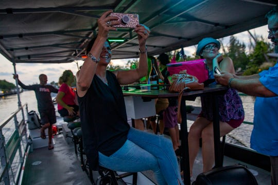 Sally Cramer takes photos while taking a ride, Thursday, June 20, 2019, on board the Naples CycleBoat in Naples.