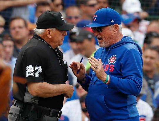Jun 21, 2019; Chicago, IL, USA; Chicago Cubs' Manager Joe Maddon speaks with umpire Larry Vanover during the fifth inning in the game against the New York Mets at Wrigley Field. Mandatory Credit: Jim Young-USA TODAY Sports