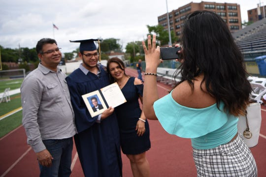 A special graduation ceremony for Hipolito Garcia Paulino from Hackensack High School before he's supposed to report to boot camp and join the U.S. Marines. (From left) Hipolito Garcia, Hipolito Garcia Paulino and Ana Virginia Paulino have their photo taken by Katherine Garcia on Friday June 21, 2019.