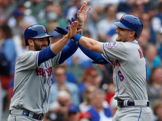 Jun 21, 2019; Chicago, IL, USA; dNew York Mets second baseman Jeff McNeil (6) celebrates his two-run home run against the Chicago Cubs with New York Mets catcher Tomas Nido (3) during the third inning at Wrigley Field. Mandatory Credit: Jim Young-USA TODAY Sports