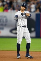 New York Yankees right fielder Giancarlo Stanton (27) reacts after hitting a double in the fourth inning against the Houston Astros at Yankee Stadium.