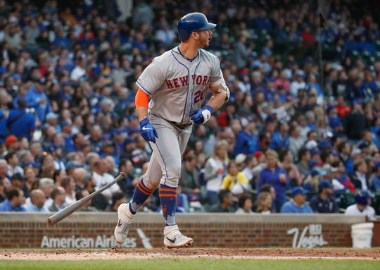 New York Mets first baseman Pete Alonso (20) watches his two run home run against the Chicago Cubs during the third inning at Wrigley Field.