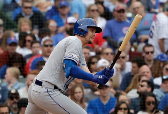New York Mets' Jeff McNeil watches after hitting a one-run single against the Chicago Cubs during the seventh inning of a baseball game in Chicago, Friday, June 21, 2019. (AP Photo/Nam Y. Huh)