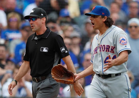 Jun 21, 2019; Chicago, IL, USA; New York Mets starting pitcher Jason Vargas (44) argues a call next to umpire David Rackley during the fifth inning at Wrigley Field. Mandatory Credit: Jim Young-USA TODAY Sports