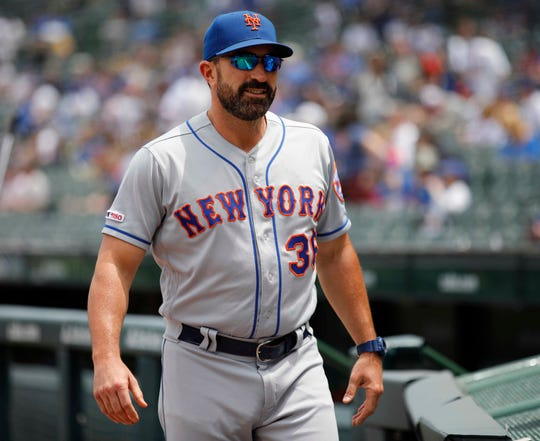Jun 21, 2019; Chicago, IL, USA; New York Mets manager Mickey Callaway (36) walks across the field before the start of a game against the Chicago Cubs at Wrigley Field. Mandatory Credit: Jim Young-USA TODAY Sports
