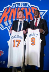 New York Knicks NBA basketball drafts picks Ignas Brazdeikis and RJ Barrett pose for photographers during a news conference, Friday, June 21, 2019, at Madison Square Garden in New York.