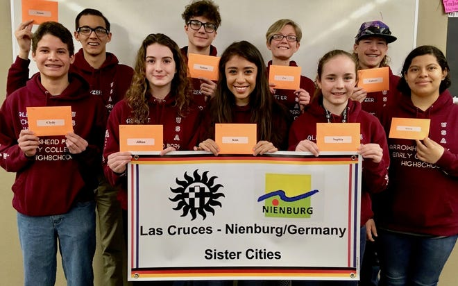 Students from Arrowhead Park Early College High School and Arrowhead Park Medical Academy with their German travel scholarship checks, tucked into orange envelopes