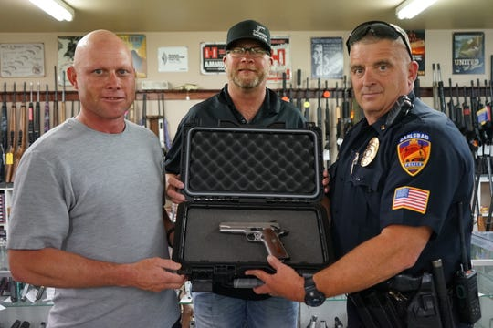 Pictured are Scott Maxwell, left, winner of a Ruger SR1911 in the Law Enforcement Torch Run's fundraiser raffle. Also pictured are Courtesy Sporting and Pawn's Shawn Mitchell and the Carlsbad Police Department's David Testa.