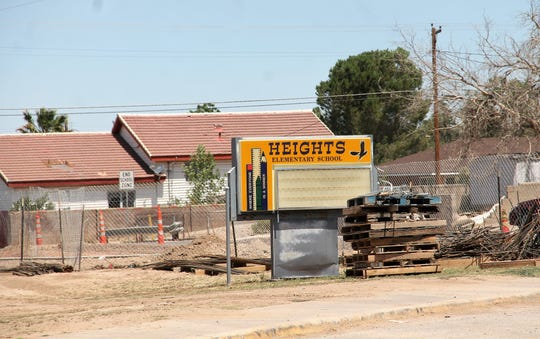 The sign at Heights Elementary with construction materials near it on June 21, 2019.