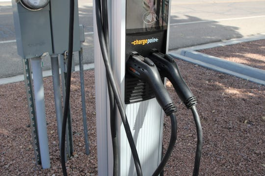 An electric vehicle charging station is pictured, Friday, June 21, 2019, in Aztec.