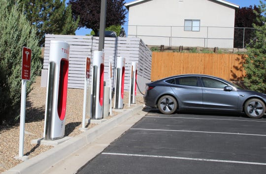 A Tesla charges at TownPlace Suites, Friday, June 21, 2019, in Farmington. Town Place Suites is one of two hotels  in the city with Tesla charging stations.