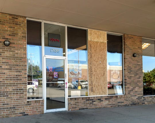 The window at Baskin Robbins in Livonia was damaged after police say a man was thrown into it during a conflict June 19 in the shopping center.