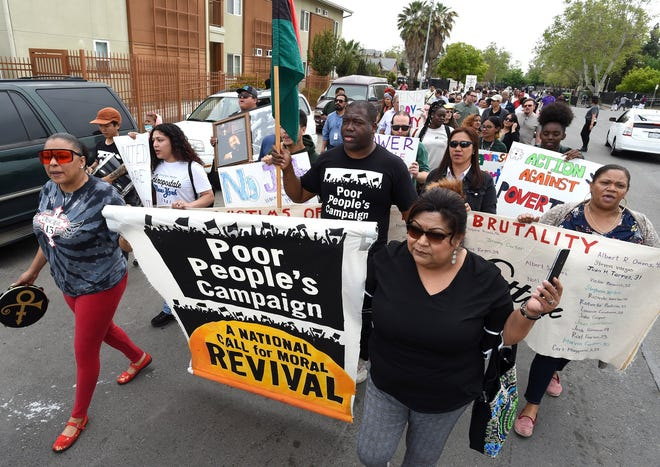 Members of the California Poor People's Campaign march in Fresno on Monday, April 8, 2019, to raise awareness about  poverty.