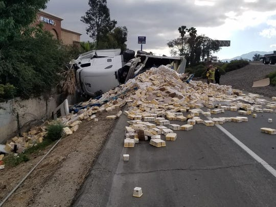 A tractor-trailer rig hauling 40,000 pounds of Earth Balance butter spread overturned off Interstate 10 on Friday, June 21, 2019.