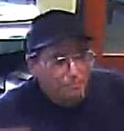 Deputies say Christopher Franco, 43, of Indio, was the man who robbed banks on Friday, June 14, 2019, and Monday, June 17, 2019. Both banks were in Palm Desert. In this image, a man is seen robbing the Pacific Premier Bank on Fred Waring Drive.