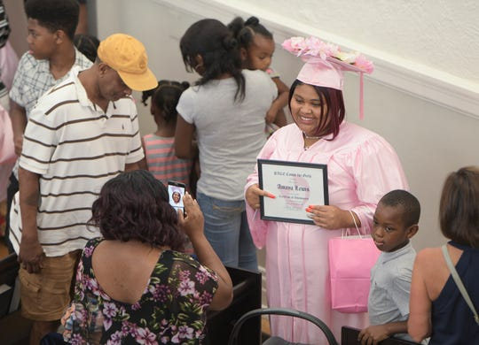 Amaya Lewis poses for a photo following the Pace Center for Girls graduation ceremony in Pensacola on Thursday.