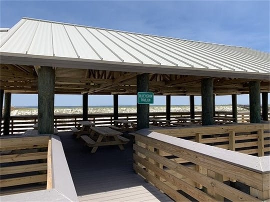 The Blue Heron Pavilion has 12 picnic tables (with ADA accessible seating) and eight grills.