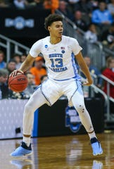 Mar 29, 2019; Kansas City, MO, United States; North Carolina Tar Heels guard Cameron Johnson (13) dribbles the ball against the Auburn Tigers in the semifinals of the midwest regional of the 2019 NCAA Tournament at Sprint Center. Mandatory Credit: Jay Biggerstaff-USA TODAY Sports