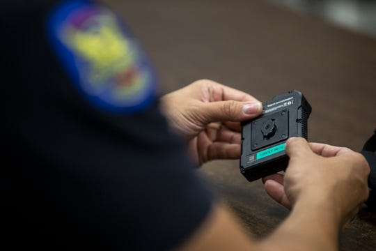 A Phoenix police officer receives an Axon body camera on Thursday, June 20, 2019, at the Phoenix Police Department South Mountain Precinct in Phoenix.