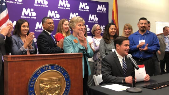 Gov. Doug Ducey signs Senate Bill 1040, which establishes a committee dedicated to understanding and preventing maternal deaths, on Friday, June 21, 2019.