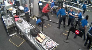 A screenshot from a video showing Tyrese Garner rushing TSA officers at a security checkpoint at Sky Harbor Airport in Phoenix.