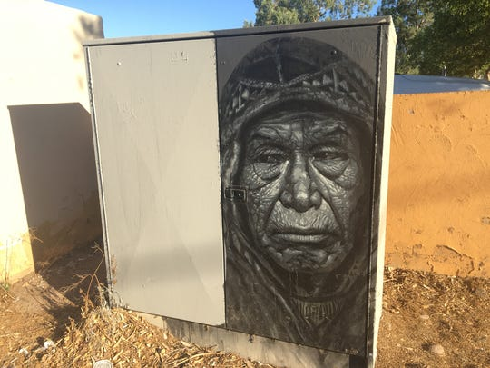 Artist Nate Benington noticed that while graffiti gets painted over, city workers sometimes leave his art up, like this portrait of an Aztec man on an electrical box in an alley near Clark Park.