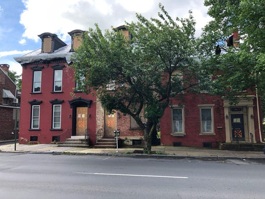 Three homes on the 400 block of Cumberland Street in Lebanon currently sit vacant, ravished by a fire, but will soon be rebuilt by Lancaster Lebanon Habitat for Humanity.