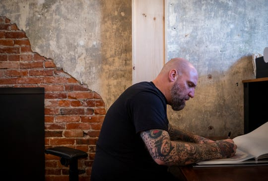 Brian Lariccia works on a drawing to be tattooed on a client at All Rise Tattoo Friday, June 21, 2019. Lariccia opened the tattoo parlor with his wife, Nicole, at 916 Military Street in downtown Port Huron.