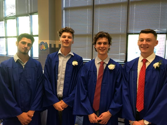 Steve Szalewicz, Mike Triglia, Lucas Rau and salutatorian Patrick Kyle pose before Millbrook High School's graduation ceremony Friday.