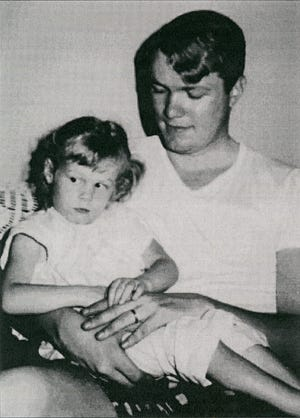 York City Police Officer Henry Schaad, 22, is shown with daughter Sharon. Officer Schaad was shot while riding in an armored vehicle on the College Avenue bridge on Friday, July 18, 1969. Schaad would die two weeks later.