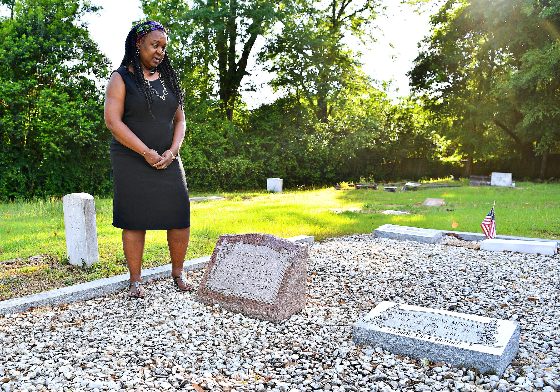 Debra Grier, 60, visits her mother's grave at Pine Lawn Cemetery in Aiken, S.C., Friday, May 3, 2019. Her mother, Lillie Belle Allen, while visiting family in York, was shot and killed during the York Riots on July 21, 1969. Dawn J. Sagert photo