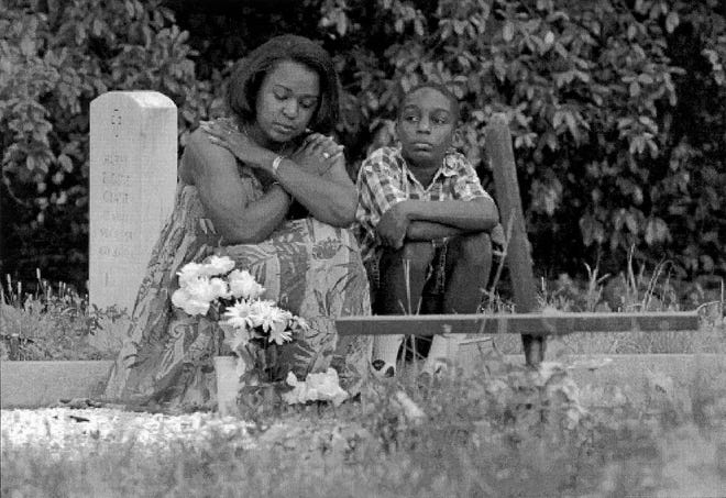 Debra Taylor, with her 10-year-old son Brandon, sists by the gravesite of her mother Lillie Belle Allen, in their hometown of Ailken, S.C. Jason Plotkin photo