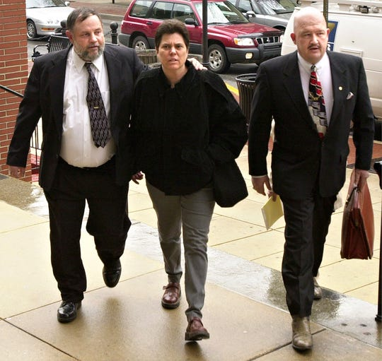Defendant Robert Messersmith, left, his wife Deb Messersmith, and Walt Traver, a paralegal to attorney Frank Arcuri, who is representing Robert's brother, Arthur Messersmith, walk into the courthouse in February 2002 for the joint pretrial hearing for eight of the men charged in the murder of Lillie Belle Allen.