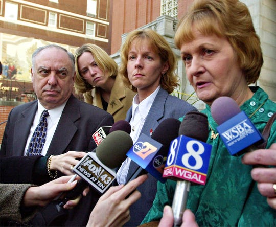 Barry Schaad and Sharon Schaad-Howe, second from right, look on as the widow of Henry Schaad, Sonja Schaad-Gilmore talks about the days events following the preliminary hearing.