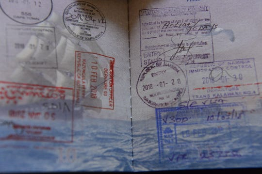 The stamped passport of Cornel Mancas following his trip across Africa in 2018.