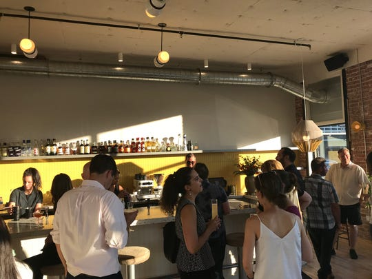 Friends and family gather in the bar of the new Jesse Hotel & Bar in Reno on June 20, 2019, in advance of the property's June 21 opening.