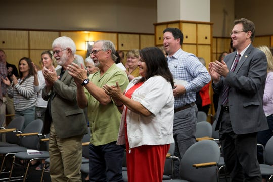 Attendees give Marion County Chief Administrative Officer John Lattimer a standing ovation during his retirement party at Courthouse Square in Salem on June 20, 2019.