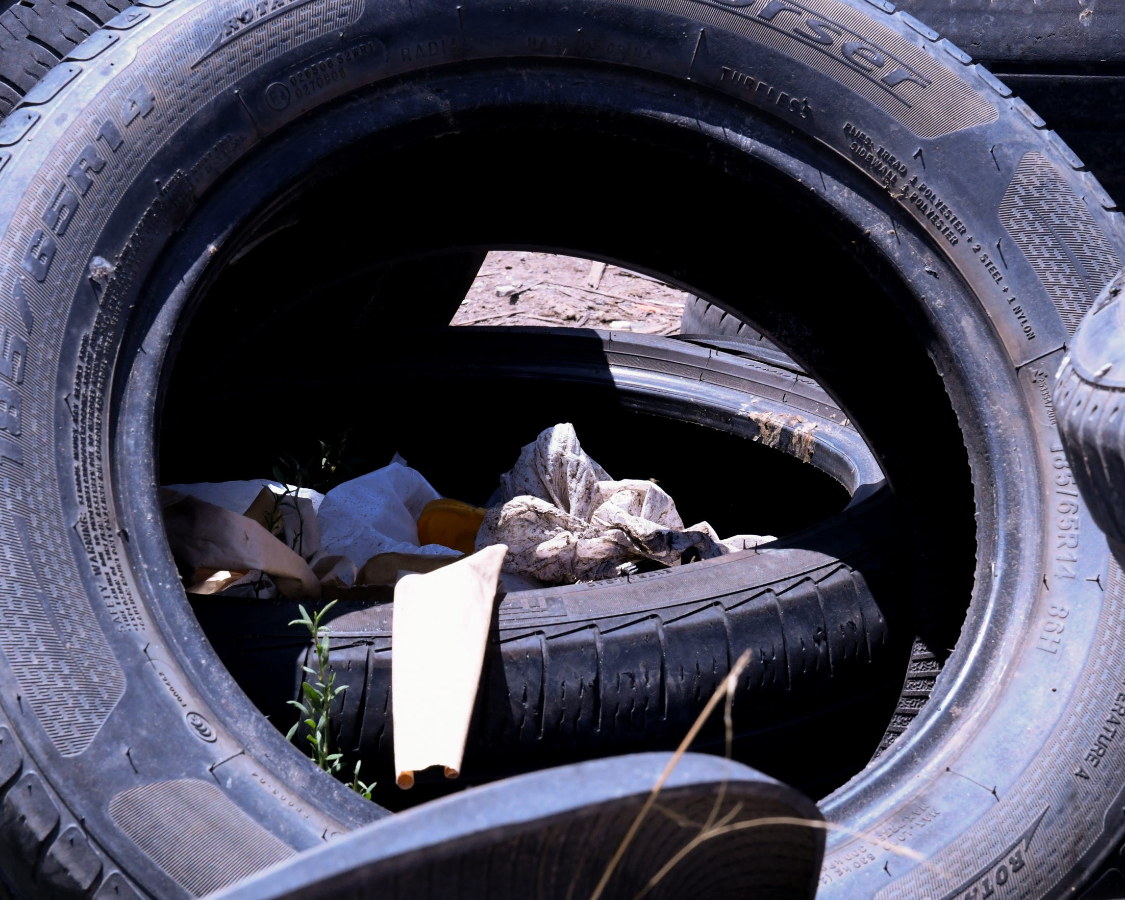 A pile of tires lies alongside the trash pile by the homeless encampment. Some local business owners say other businesses dump them there to avoid remittance fees. June 19, 2019.