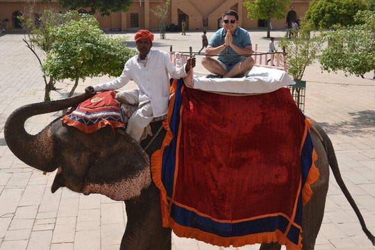 Ender De Leon rides an elephant during a learning trip to India with his Hardin-Simmons University psychology classmates in May 2019.