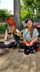 Jenny Foster poses with a snake charmer during a educational trip to India with psychology class peers from Hardin Simmons University in May 2019.