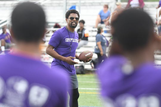 Jack Brewer, former NFL Safety, runs the PAL Kids (Police Athletic League) through drills at the Salisbury University Intramural fields on Friday, June 21, 2019